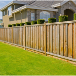 How high should a wood fence be off the ground?
